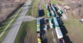Flying Over Trains In Train Yard Aerial View 4K