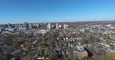 Flying Over Poor Neighborhood Lower Class Towards City Metropolitan Core 4K 2 Stock Footage