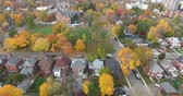 Beautiful Autumn Trees in Old Rustic Neighborhood Fly Over Aerial
