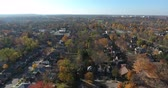 Orange Red and Green Autumn Trees in Dense Neighborhood Aerial Drone View