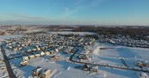 Snow Covered Rooftops and New Real Estate In Winter Aerial Flyover