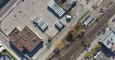 konak : Trucking Shipping Company By Train Tracks Aerial Flyover Drone View