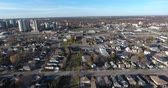 Flying Over Blue Collar Neighborhood in Richtung Highschool Football Field 4K