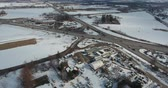 zasněžené : Ascending Over Triangle Intersection With Gas Station And Industrial Area In Winter Aerial