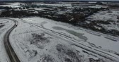 dálnice : Descending Towards Road Near Pond And Industrial Section In Winter Aerial View