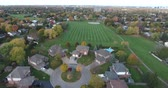 mowed : Flying Above Cul De Sac Revealing Park With Soccer Field In Distance Aerial View Stock Footage