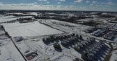 país das maravilhas : Flying Over Subdivision Towards Ice Pond In Winter Aerial Stock Footage