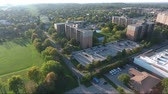 szerény : Flying Towards Apartment Jungle With Bokeh And Park On Side Aerial View
