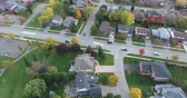 скромный : Low Angle View Of House Rooftops With Traffic On Road Aerial Стоковые видеозаписи