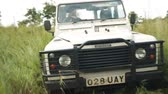 защитник : A Landrover drives down an overgrown dirt track in rural Uganda, Africa