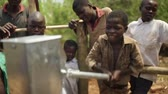 elation : Happy African kids celebrate the installtion of a new water well in their village