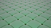 feixes : 3D animation of the flight over a light green quilted velvet surface with green drawstrings. Looped video. Vídeos