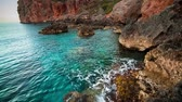 lugar : Picturesque Mediterranean seascape in Turkey. Colorful morning of the Pirate Bay on Gelidonya peninsula, District of Kumluca, Antalya Province. Full HD video (High Definition). Exported from RAW file.
