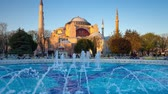 Colorful spring scene in Sultan Ahmet park in Istanbul, Turkey, Europe. Fountain on the background of the Ayasofya Museum (Hagia Sophia). Full HD video (High Stock Footage