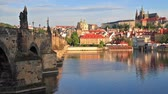 řeka : Colorful morning view with Charles Bridge and Prague Castle and St. Vitus cathedral on Vltava river. Sunny spring scene in Prague, Czech Republic, Europe. Full HD video (High Definition).