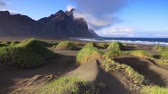 escandinávia : Black sand dunes on the Stokksnes headland on southeastern Icelandic coast. Iceland, Europe. Full HD video (High Definition). Vídeos