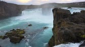 flow : White night view of the Godafoss Waterfall in Iceland, Europe. Full HD video (High Definition).