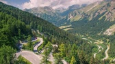 Moving cars on a mountain Maloja Pass sunny summer morning. Alps, Switzerland, Europe. Full HD video (High Definition). Exported from RAW file. Stock Footage