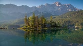 Colorful summer sunrise on the Eibsee lake in German Alps. Germany, Europe.