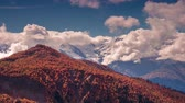 Time lapse clip. Moving fluffy clouds in autumn morning in the Caucasus mountains. Mheer mountain range, Upper Svaneti, Georgia, Europe. 4K video (Ultra High Definition).