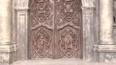 intramuros : zoom-in shot of carved doors of san agustin church, intramuros, manila philippines. national historical landmark.