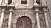 intramuros : vertical pan shot of san agustin church, intramuros, manila philippines. national historical landmark.