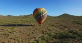 overcome fear : Hot air balloon in open desert fly away Stock Footage