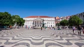 undulation : Lisbon, Portugal. August 31, 2014: Dona Maria II National Theatre seen across the Dom Pedro IV Square, better known as Rossio, with the typical handmade cobblestone pavement with a wave design Stock Footage