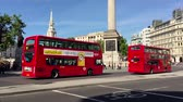 tornar : LONDON - MAY 2015: Bus in city street, slow motion, London.This buses have become an icon of Britain and are a major tourist attraction in themselves