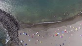 bakire : Overhead view of beautiful beach and swimmers Stok Video
