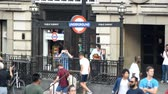 Лондон : LONDON? JULY 2015: Tourists and locals at subway station entrance. London attracts 30 million people annually Стоковые видеозаписи
