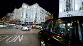 LONDON - JUNE 2015: Piccadilly traffic at night. London attract 15 million tourists annually Stock Footage