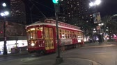 wealthy : NEW ORLEANS - FEBRUARY 9, 2016: Streetcar on Canal Street at night. It is the oldest continuously operating street railway system in the world