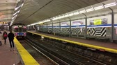 tunel : BOSTON - OCTOBER 2015: Train arrives at subway station. The city attracts 10 million tourists annually. Dostupné videozáznamy