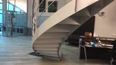Interior of modern office with chair and stairs Vidéos Libres De Droits