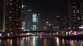 kasım : DUBAI, UAE - DECEMBER 2016: Dubai Marina skyline at night from promenade. Dubai attracts 15 million people annually