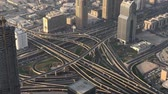 viagens de negócios : DUBAI, UAE - DECEMBER 2016: Aerial view of traffic intersections. Dubai suffers heavy car traffic