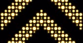 Yellow nightclub stage backdrop LED matrix panel lights thick arrow pattern visual on a black background, animated in a twinkling upwards movement motion.