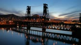 fremont : Moving Traffic on Steel Bridge in Portland Oregon Downtown Blue Hour Sunset with Water Reflection along Willamette River at Night 1920x1080 Stock Footage