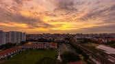 Time lapse zooming out movie of sunrise and auto traffic by Eunos MRT Station in Singapore. Eunos is a planned residential neighborhood east of the Central Area. 1920x1080 Стоковые видеозаписи