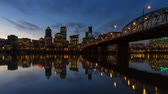 Panning Time Lapse Movie of Portland Oregon Downtown Cityscape with Hawthorne Bridge and Water Reflection from Blue Hour into Night Scene 1920x1080 Стоковые видеозаписи