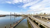 fremont : Ultra high definition 4k timelapse movie of fast moving highway traffic and white clouds over downtown Portland Oregon with Steel bridge along Willamette River during rush hour 4096x2304