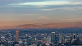 Time lapse movie of clouds and sky over cityscape with alpenglow on beautiful snow covered Mt. Hood in Portland Oregon at sunset into evening 4k 4096x2304 uhd Dostupné videozáznamy