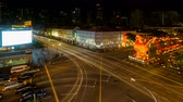 Ultra high definition time lapse movie of long exposure auto light trails and Chinese New Year of the Rooster festive celebration decorations in Chinatown in Singapore at night 4096x2304