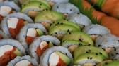 High definition video panning of a platter of delicious and fresh sushi rolls prepared with both raw and cooked ingredients 1080p HD