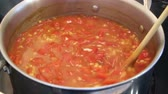 tomato lentils and barley soup boiling