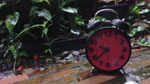 Clock running slow with rain drop slash in slow motion Wideo