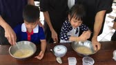 creme : Family with small children are cooking in a Bakery cooking class.