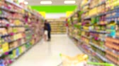 bem : Blurred shot of consumers in supermarket from shopping cart