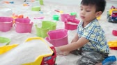 00:00 | 00:16 1× Asian boy is playing with educational toy in sandbox